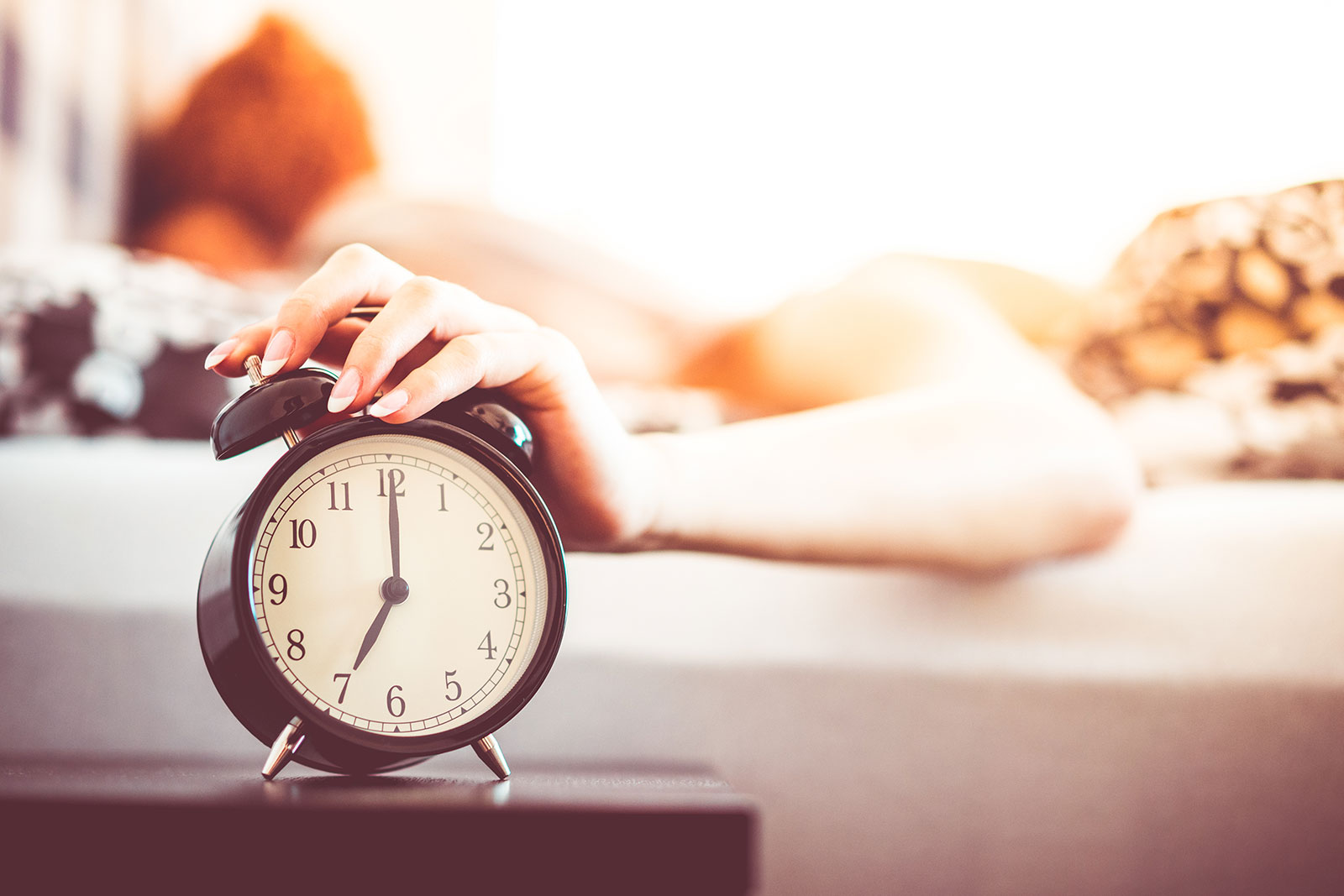 Woman Shutting Off Ringing Alarm Clock From Bed  - woman shutting off ringing alarm clock from bed picjumbo com - Young Woman Walking Alone in Prague Streets