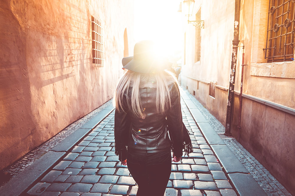 Young Woman Walking Alone in Prague Streets  - young woman walking alone in prague streets picjumbo com - Young Woman Walking Alone in Prague Streets